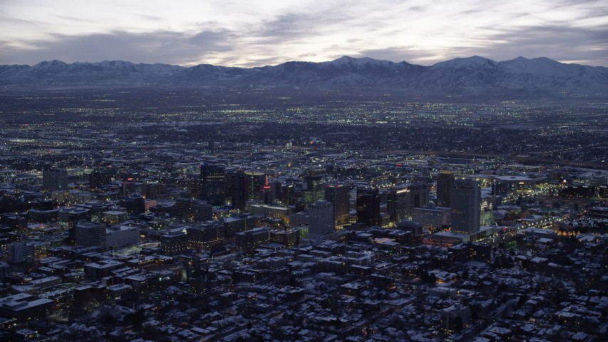 6K stock footage aerial video of a wide orbit of Downtown Salt Lake City, Utah with winter snow at twilight Aerial Stock Footage | AX128_055