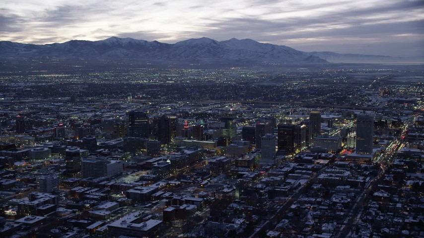 6K stock footage aerial video orbit east side of Downtown Salt Lake City with winter snow at twilight, Utah Aerial Stock Footage | AX128_056