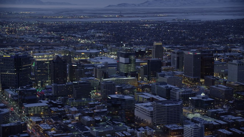 6K stock footage aerial video of orbiting buildings in Downtown SLC, Utah with winter snow at twilight Aerial Stock Footage | AX128_059