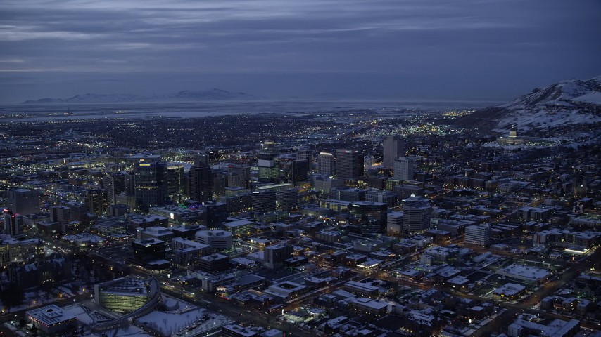 6K stock footage aerial video of a wide orbit of Downtown Salt Lake City and the capitol with snow at twilight, Utah Aerial Stock Footage | AX128_060