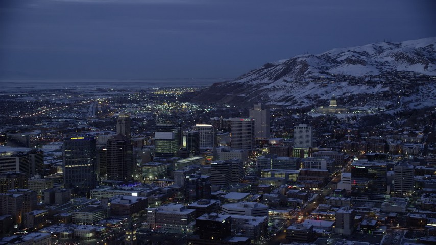 6K stock footage aerial video orbit southeast side of Downtown SLC and capitol with winter snow at night, Utah Aerial Stock Footage | AX128_061