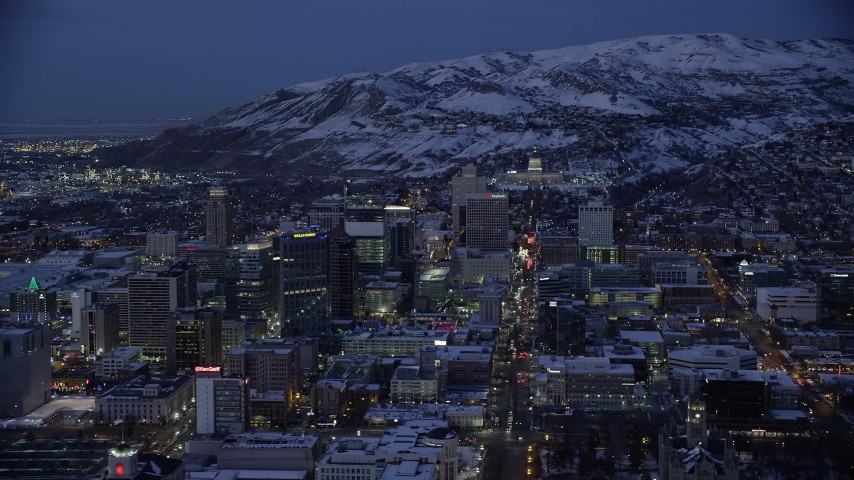 6K stock footage aerial video orbit Downtown Salt Lake City and State Street to the capitol with winter snow at Night, Utah Aerial Stock Footage | AX128_062