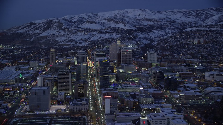 6K stock footage aerial video orbit from Main to West Temple Street in Downtown Salt Lake City with winter snow at night, Utah Aerial Stock Footage | AX128_063