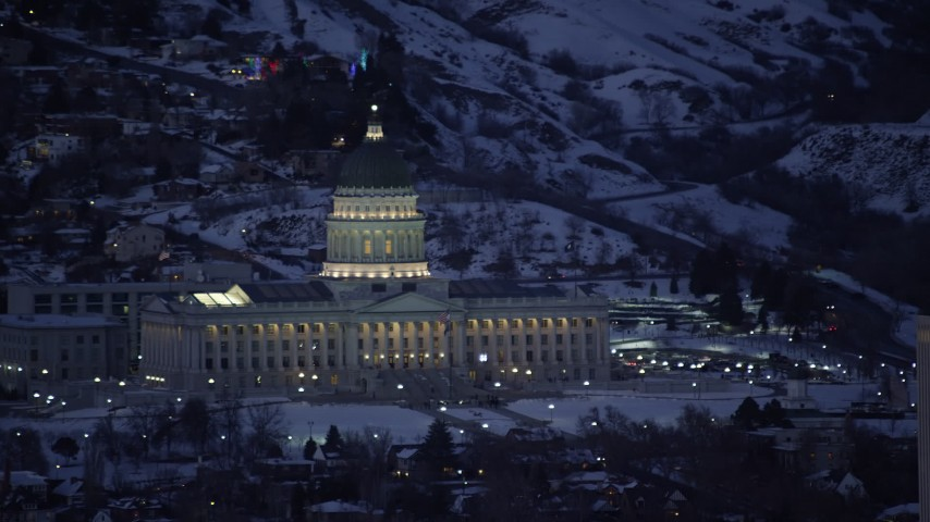 6K stock footage aerial video orbit front side of Utah State Capitol with winter snow at night, Salt Lake City Aerial Stock Footage | AX128_064