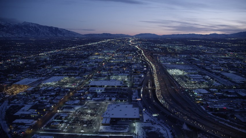 6K stock footage aerial video fly over shopping center, approach freeway with heavy traffic at twilight, Salt Lake City, Utah Aerial Stock Footage | AX128_066