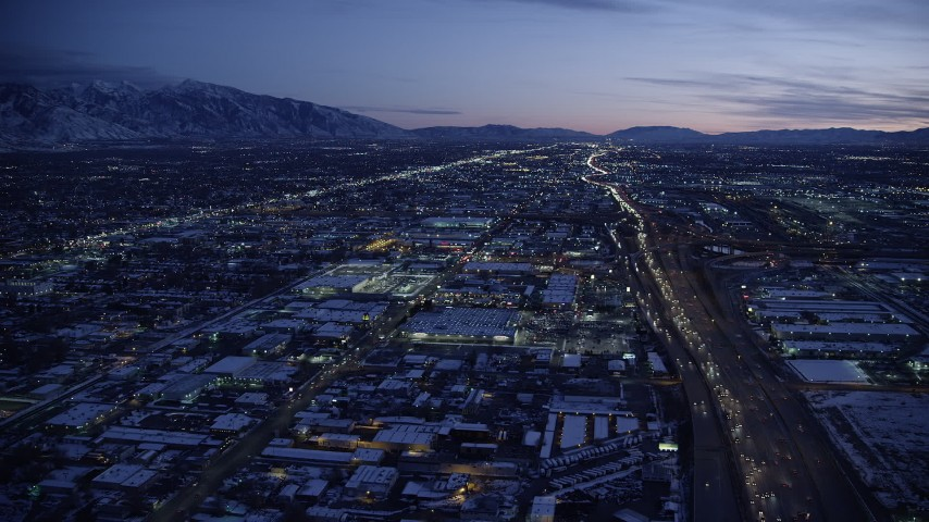 6K stock footage aerial video approach shopping center by I-15 with heavy traffic in winter at twilight, Salt Lake City, Utah Aerial Stock Footage | AX128_068