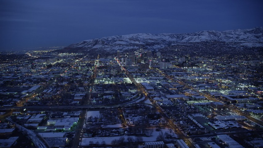 6K stock footage aerial video of flying north to approach Downtown Salt Lake City at Night in winter, Utah Aerial Stock Footage | AX128_069