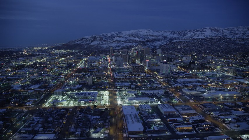 6K stock footage aerial video fly over West Temple toward State Street, Downtown SLC, Utah with winter snow at night Aerial Stock Footage | AX128_070