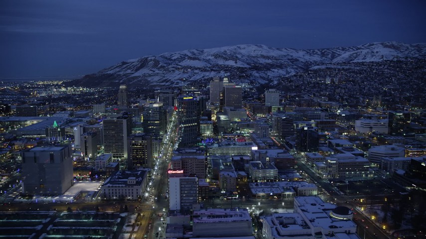 6K stock footage aerial video fly over Main Street toward State Street in Downtown SLC with winter snow at night, Utah Aerial Stock Footage | AX128_072