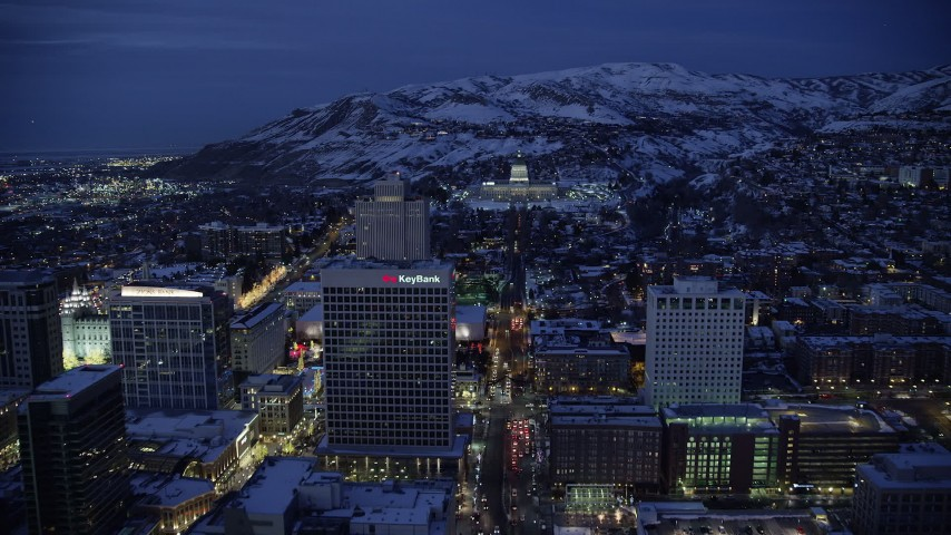 6K stock footage aerial video approach Utah State Capitol at end of State Street from Downtown SLC with winter snow at night Aerial Stock Footage | AX128_074
