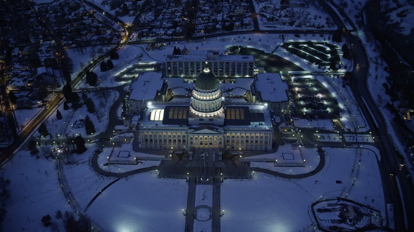 Tilt to Bird's Eye View of the Utah State Capitol with Winter Snow at Night Aerial Stock Footage AX128_076