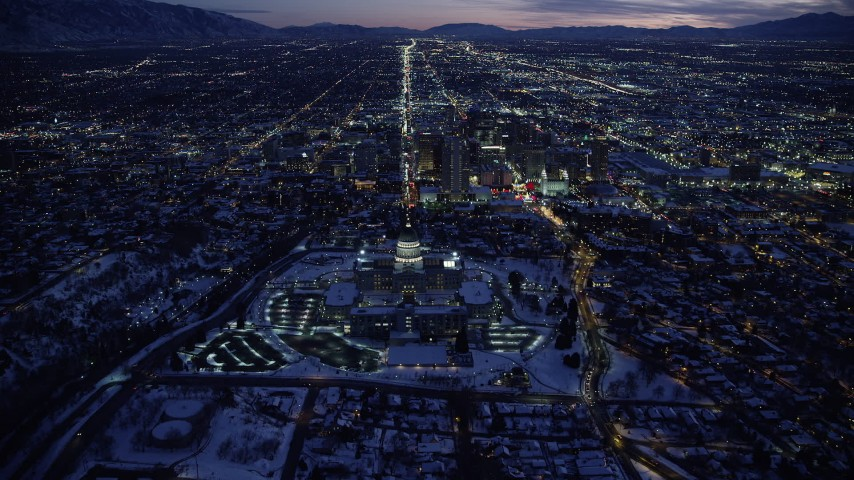 6K stock footage aerial video approach Utah State Capitol and Downtown SLC with winter snow from the north at twilight Aerial Stock Footage | AX128_078