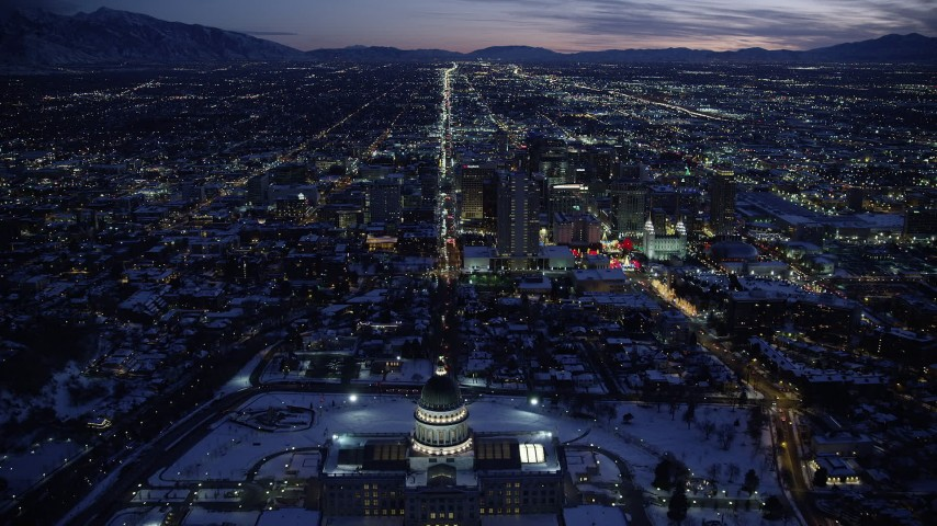 6K stock footage aerial video fly over Utah State Capitol and approach State Street through Downtown SLC in winter twilight Aerial Stock Footage | AX128_079