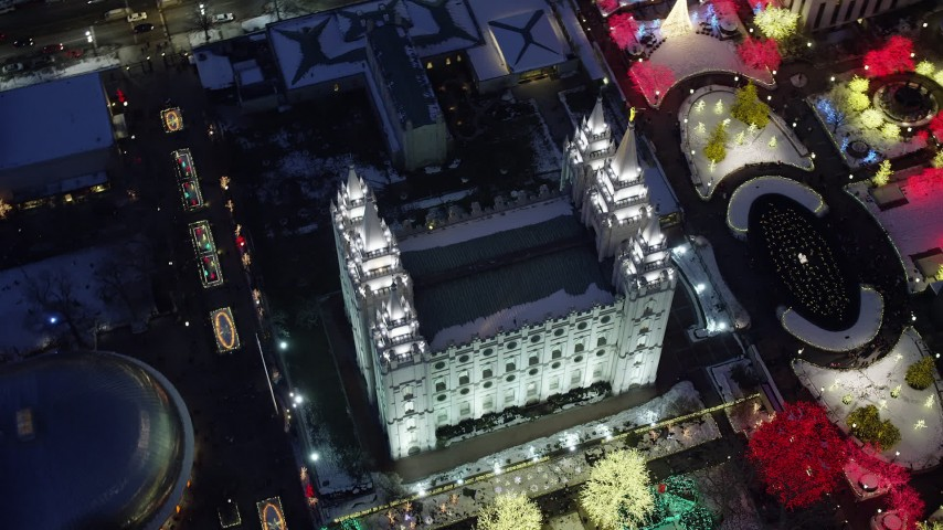 Bird's Eye Orbit of Salt Lake Temple with Christmas Lights and Snow at Night Aerial Stock Footage | AX128_082