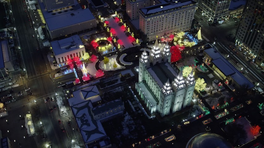 6K stock footage aerial video orbit Salt Lake Temple with snow and Christmas lights at night, Downtown Salt Lake City, Utah Aerial Stock Footage | AX128_083