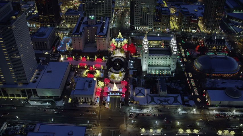 Orbit Salt Lake Temple with Christmas Lights and Winter Snow at Night Aerial Stock Footage | AX128_084