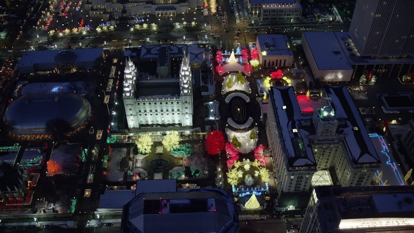 Orbit Salt Lake Temple with Christmas Lights and Winter Snow at Night Aerial Stock Footage | AX128_087