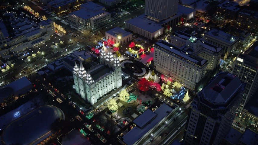 Orbit Salt Lake Temple Decorated for Christmas with Snow at Night Aerial Stock Footage | AX128_088
