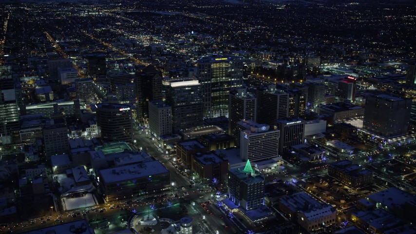 6K stock footage aerial video of Downtown Salt Lake City office buildings and city streets in winter at night, Utah Aerial Stock Footage | AX128_089