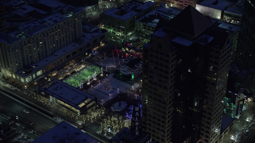 6K stock footage aerial video orbit office buildings and Gallivan Center, lit for Christmas in winter at night. Downtown SLC, Utah Aerial Stock Footage | AX128_095