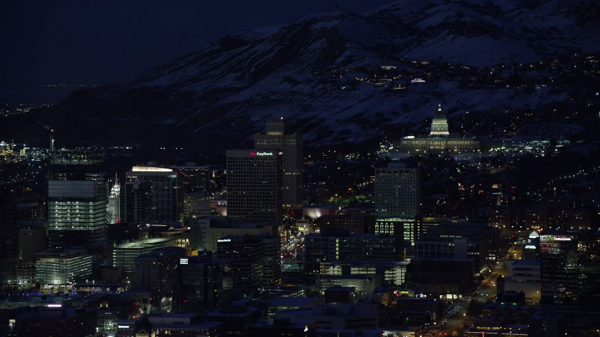6K stock footage aerial video of Utah State Capitol on the north end of Downtown Salt Lake City with winter snow at night Aerial Stock Footage | AX128_098