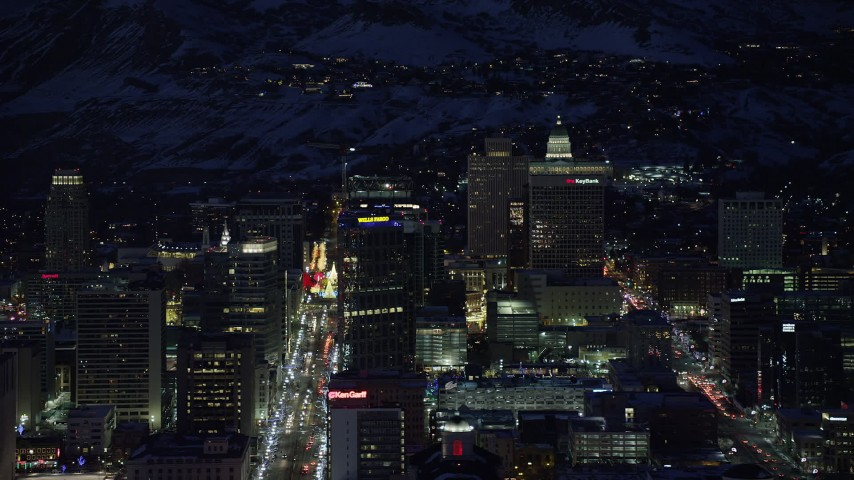 6K stock footage aerial video of tall office buildings around Main Street in Downtown Salt Lake City, Utah in winter at night Aerial Stock Footage | AX128_100