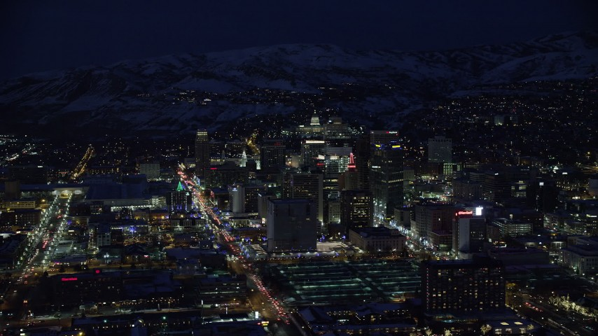 6K stock footage aerial video orbit Downtown Salt Lake City in winter at night, Utah Aerial Stock Footage | AX128_101