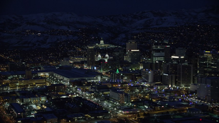 6K stock footage aerial video orbit the Utah State Capitol by Downtown Salt Lake City in winter at night Aerial Stock Footage | AX128_102