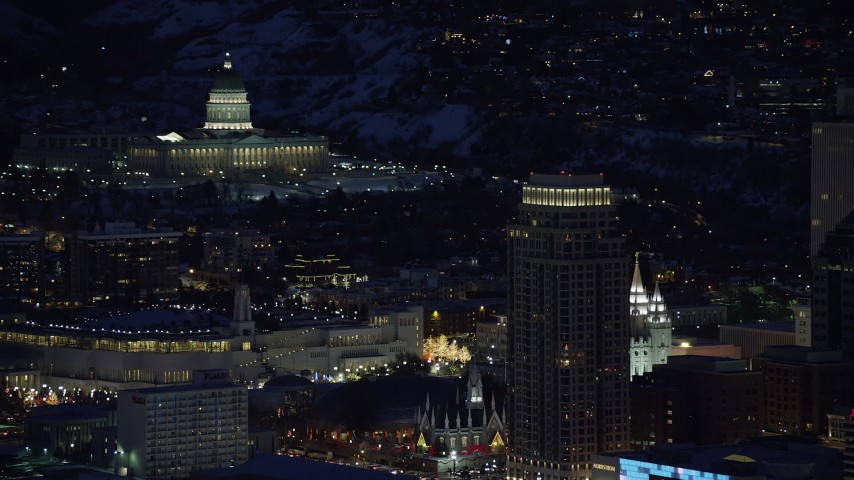 Orbit State Capitol and Salt Lake Temple at Night in Winter Aerial Stock Footage | AX128_103