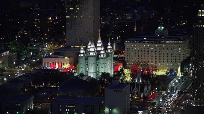 6K stock footage aerial video orbit Salt Lake Temple with Christmas lights at night in wintertime, Downtown Salt Lake City, Utah Aerial Stock Footage | AX128_105