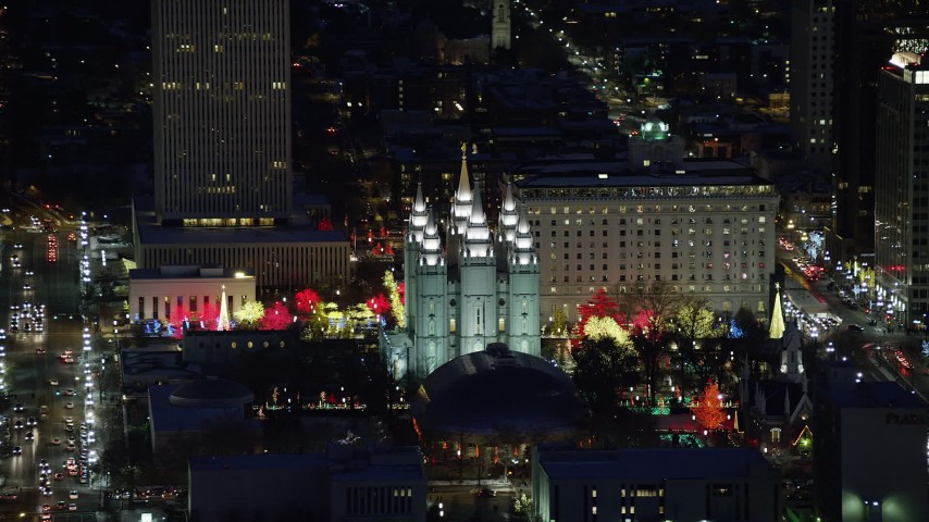 6K stock footage aerial video orbit Salt Lake Temple with bright Christmas lights at night in winter, Downtown Salt Lake City, Utah Aerial Stock Footage | AX128_106