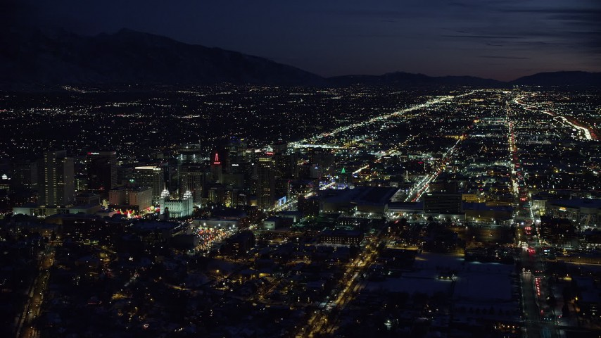 Wide Orbit of Salt Lake Temple and Downtown at Night in Winter Aerial Stock Footage | AX128_110