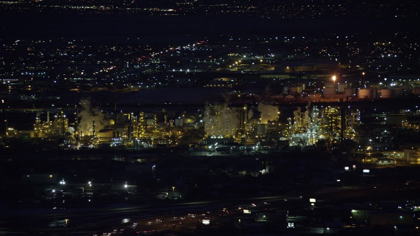 Orbiting a Large Refinery at Night in Wintertime Aerial Stock Footage | AX128_111
