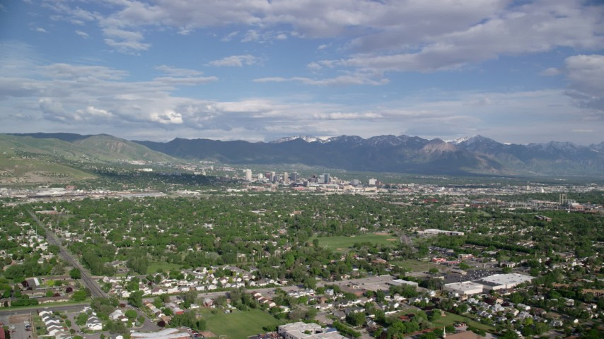 6K stock footage aerial video of flying over suburbs, approaching Downtown Salt Lake City, Utah Aerial Stock Footage | AX129_001