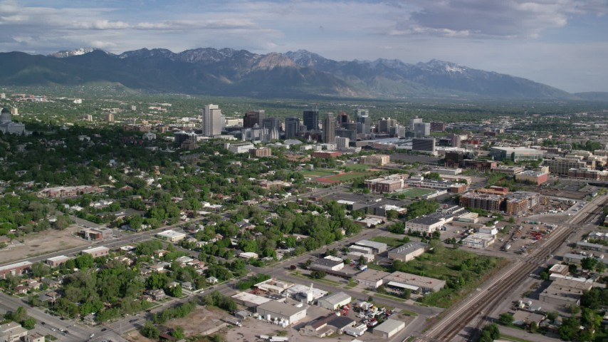6K stock footage aerial video of flying by city buildings, neighborhoods, sports fields, Downtown Salt Lake City, Utah Aerial Stock Footage | AX129_006