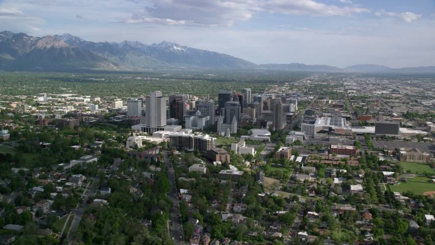 6K stock footage aerial video flyby city buildings, homes, sports fields, Downtown Salt Lake City, Utah Aerial Stock Footage | AX129_008