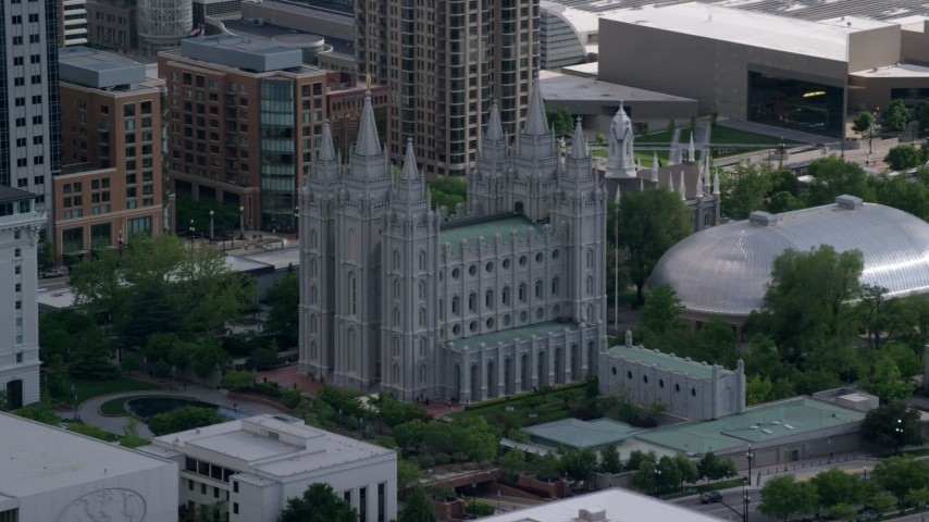 6K stock footage aerial video of flying by Salt Lake Temple and Mormon Tabernacle, Downtown Salt Lake City, Utah Aerial Stock Footage | AX129_010