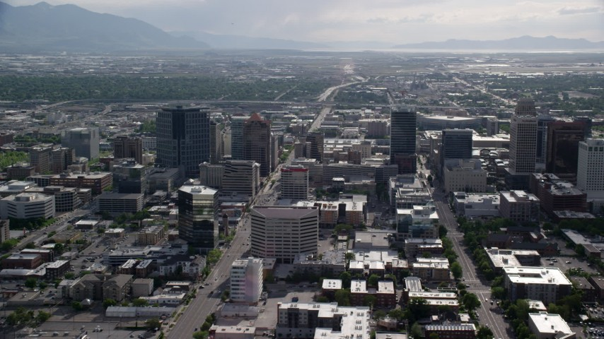 Flying by buildings, city streets, Downtown Salt Lake City, Utah Aerial Stock Footage | AX129_011