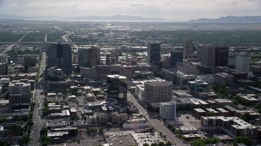 Flying by buildings, city streets, Downtown Salt Lake City, Utah Aerial Stock Footage | AX129_012