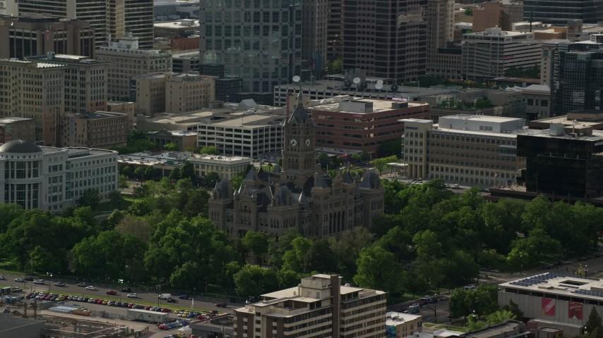 6K stock footage aerial video of flying by Salt Lake City Hall, Downtown Salt Lake City, Utah Aerial Stock Footage | AX129_013