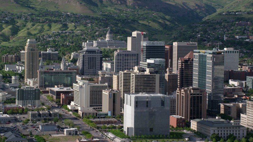 6K stock footage aerial video of flying by city buildings, revealing Utah State Capitol, Downtown Salt Lake City, Utah Aerial Stock Footage | AX129_016