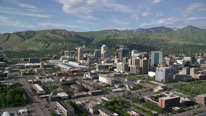 6K aerial stock footage video of Wasatch Range behind Downtown Salt Lake City, Utah Aerial Stock Footage | AX129_017