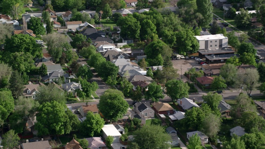 Flying by suburban residential neighborhood, Salt Lake City, Utah Aerial Stock Footage | AX129_023