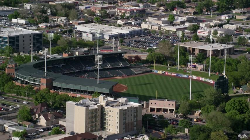 Orbiting Spring Mobile Ballpark during a baseball game, Salt Lake City, Utah Aerial Stock Footage | AX129_028