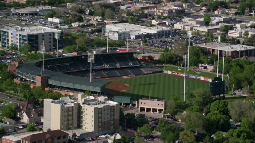6K stock footage video of circling Spring Mobile Ballpark during a game, Salt Lake City, Utah Aerial Stock Footage | AX129_028
