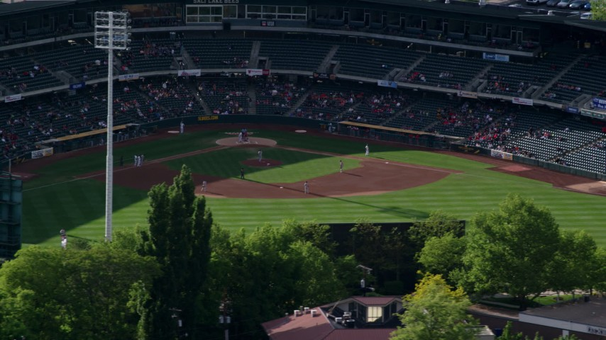 Orbiting Spring Mobile Ballpark during a baseball game, Salt Lake City, Utah Aerial Stock Footage | AX129_030