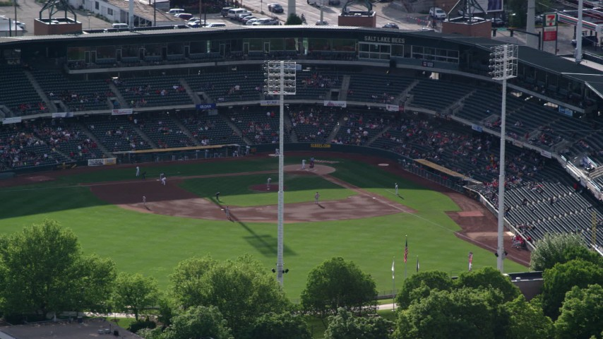 6K stock footage aerial video of circling Spring Mobile Ballpark with players on the field, Salt Lake City, Utah Aerial Stock Footage | AX129_031
