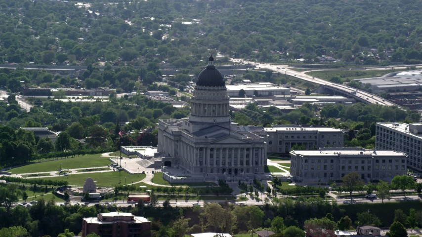 Flying by the Utah State Capitol, Capitol Hill, Salt Lake City, Utah Aerial Stock Footage | AX129_035