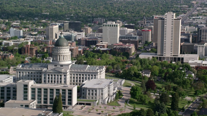 6K stock footage aerial video of flying by Utah State Capitol, city buildings in Downtown Salt Lake City, Utah Aerial Stock Footage | AX129_042