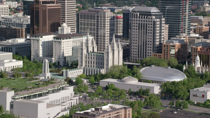Flying by Salt Lake Temple, Mormon Tabernacle, Downtown Salt Lake City, Utah Aerial Stock Footage AX129_043